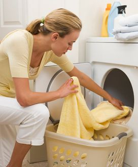 Woman taking laundry out of dryer